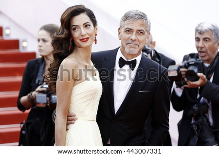 CANNES, FRANCE - MAY 12: Actor George Clooney and his wife Amal Alamuddin Clooney attend the 'Money Monster' premiere during the 69th Cannes Film Festival on May 12, 2016 in Cannes, France. - stock photo