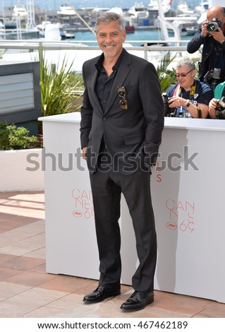 "CANNES, FRANCE - MAY 12, 2016: Actor George Clooney at the photocall for ""Money Monster"" at the 69th Festival de Cannes."