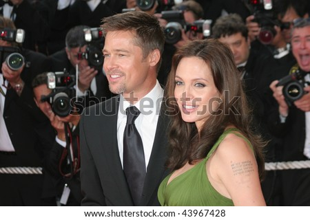 CANNES, FRANCE - MAY 15: Actors Angelina Jolie and Brad Pitt attend the 'Kung Fu Panda' premiere at the Palais des Festivals during the 61st Cannes  Film Festival on May 15, 2008 in Cannes, France. - stock photo