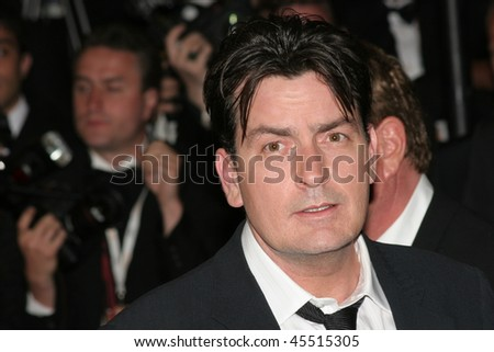 CANNES, FRANCE - MAY 21: Actors Charlie Sheen attends the 'Platoon' Screening at the Palais during the 59th International Cannes Film Festival May 21, 2006 in Cannes, France - stock photo