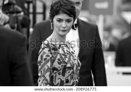 CANNES, FRANCE - MAY 14, 2014: Actress Audrey Tautou walks down the red carpet during the 67th Annual Cannes Film Festival on May 14, 2014 in Cannes, France. - stock photo