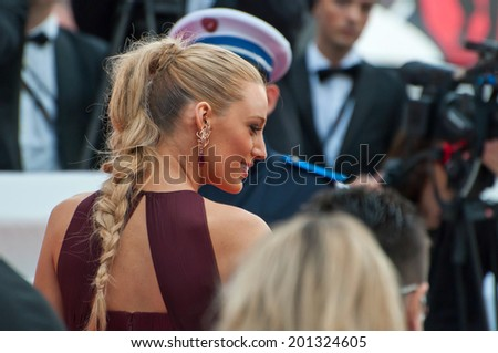 CANNES, FRANCE - MAY 14, 2014: Actress Blake Lively walks down the red carpet during the 67th Annual Cannes Film Festival on May 14, 2014 in Cannes, France. - stock photo
