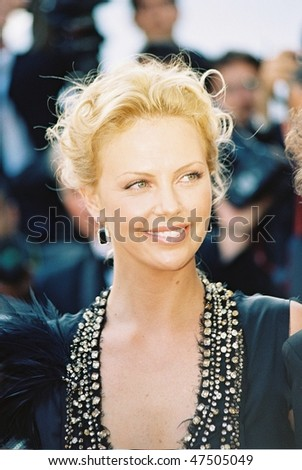 CANNES, FRANCE - MAY 21: Actress Charlize Theron attends 'The Life And Death Of Peter Sellers' premiere at Le Palais de Festival at the 57th Cannes Film Festival on May 21, 2004 in Cannes, France - stock photo