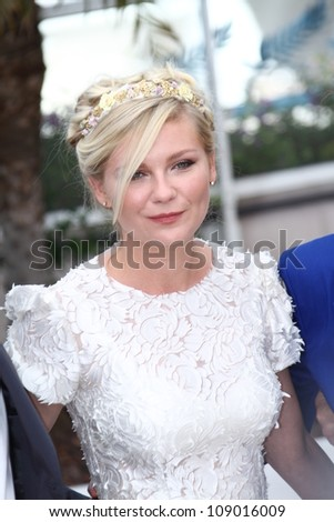 CANNES, FRANCE - MAY 23: Actress Kirsten Dunst attends the 'On The Road' Photocall during the - 65th Annual Cannes Film Festival at Palais des Festivals on May 23, 2012 in Cannes, France. - stock photo
