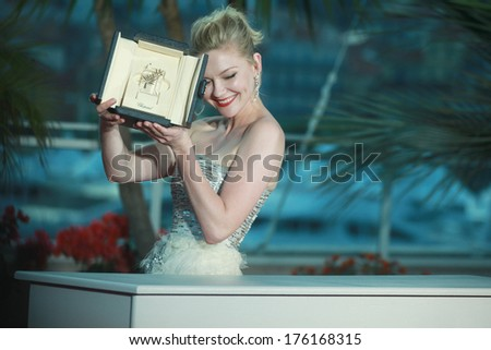 CANNES, FRANCE - MAY 22: Actress Kirsten Dunst with her Award for Best Actress in the film 'Melancholia' during photocall at the 64th Annual Cannes Film Festival on May 22, 2011 in Cannes, France.  - stock photo