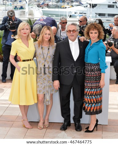CANNES, FRANCE - MAY 11, 2016: Actresses Kirsten Dunst, Vanessa Paradis, Valeria Golino with director George Miller at the photocall for the Jury at the 69th Festival de Cannes.