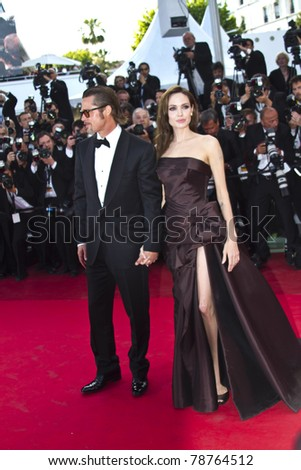 CANNES, FRANCE - MAY 16: Angelina Jolie, Brad Pitt attend 'The Tree Of Life' premiere during the 64th Annual Cannes Film Festival at Palais des Festivals on May 16, 2011 in Cannes, France. - stock photo