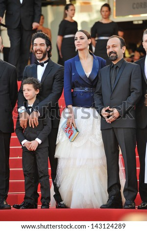 "CANNES, FRANCE - MAY 17, 2013: Berenice Bejo & director Aghar Farhadi & cast at the gala premiere of their movie ""The Past"" (Le Passe) in competition at the 66th Festival de Cannes."