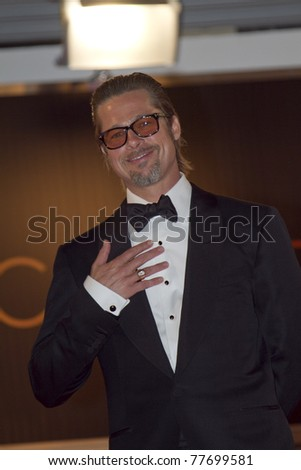 CANNES, FRANCE - MAY 16: Brad Pitt departs 'The Tree Of Life' premiere during the 64th Annual Cannes Film Festival at Palais des Festivals on May 16, 2011 in Cannes, France - stock photo