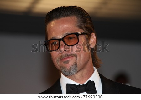 CANNES, FRANCE - MAY 16: Brad Pitt departs 'The Tree Of Life' premiere during the 64th Annual Cannes Film Festival at Palais des Festivals on May 16, 2011 in Cannes, France