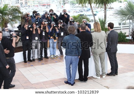 CANNES, FRANCE - MAY 22: Brad Pitt, Ray Liotta pose at the 'Killing Them Softly' photocall during the 65th Annual Cannes Film Festival at Palais des Festivals on May 22, 2012 in Cannes, France. - stock photo