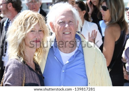 CANNES, FRANCE - MAY 23: Bruce Dern and Laura Dern attend the Photocall for 'Nebraska' during The 66th Annual Cannes Film Festival at the Palais des Festival on May 23, 2013 in Cannes, France. - stock photo
