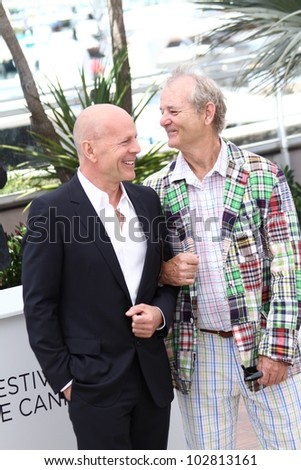 CANNES, FRANCE - MAY 16: Bruce Willis and Bill Murray pose at the 'Moonrise Kingdom' photocall during the 65th Annual Cannes Film Festival at Palais des Festivals on May 16, 2012 in Cannes, France. - stock photo