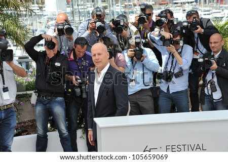 "CANNES, FRANCE - MAY 16, 2012: Bruce Willis at the photocall for his new movie ""Moonrise Kingdom"" at the 65th Festival de Cannes. May 16, 2012  Cannes, France"