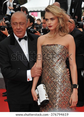 "CANNES, FRANCE - MAY 21, 2014: Cara Delevingne & Fawaz Gruosi at the gala premiere of ""The Search"" at the 67th Festival de Cannes."