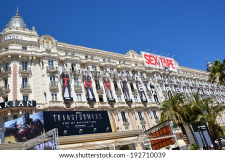 CANNES, FRANCE- MAY 14: Carlton hotel shown in may 14, 2014 in Cannes, France. The facade of this luxurious hotel is decorated for the 67th International Film Festival rewarded by the golden palm. - stock photo