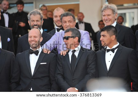 "CANNES, FRANCE - MAY 18, 2014: Cast of The Expendables 3 promoting their new movie ""The Expendable 3"" at the 67th Festival de Cannes."