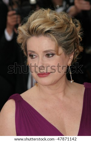 CANNES, FRANCE - MAY 11: Catherine Deneuve attends the 58th Cannes Film Festival Opening Ceremony and premiere of opening film 'Lemming'at the Grand Theatre Lumiere on May 11, 2005 in Cannes, France - stock photo