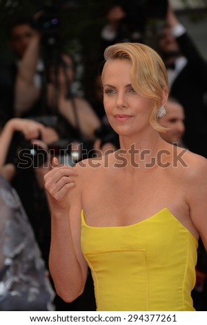 "CANNES, FRANCE - MAY 14, 2015: Charlize Theron at the gala premiere of her movie ""Mad Max: Fury Road"" at the 68th Festival de Cannes.