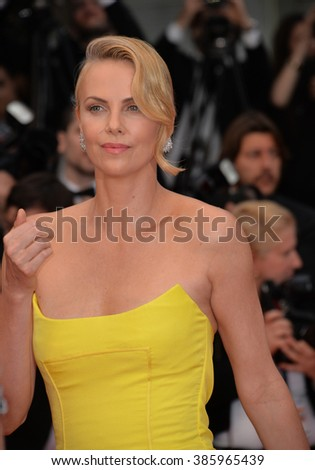 "CANNES, FRANCE - MAY 14, 2015: Charlize Theron at the gala premiere of her movie ""Mad Max: Fury Road"" at the 68th Festival de Cannes. - stock photo"