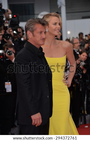 "CANNES, FRANCE - MAY 14, 2015: Charlize Theron & Sean Penn at the gala premiere of her movie ""Mad Max: Fury Road"" at the 68th Festival de Cannes.