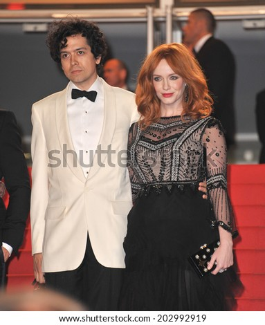 """CANNES, FRANCE - MAY 20, 2014: Christina Hendricks & husband Geoffrey Arend at the gala premiere of her movie """"Lost River"""" at the 67th Festival de Cannes.  - stock photo"""