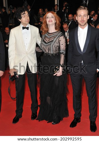 "CANNES, FRANCE - MAY 20, 2014: Christina Hendricks & husband Geoffrey Arend & Ryan Gosling at the gala premiere of her movie ""Lost River"" at the 67th Festival de Cannes.  - stock photo"
