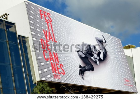 CANNES, FRANCE - MAY 14: Conference Hall facade shown in may 14, 2013 in Cannes, France. Palais des Festivals with the official poster for the sixty sixth international movie festival. - stock photo