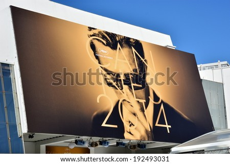 CANNES, FRANCE-MAY 13: Conference hall facade shown on may 13, 2014 in Cannes, France. The official poster for the 67th International Film Festival with the famous  italian actor Marcello Mastroianni. - stock photo