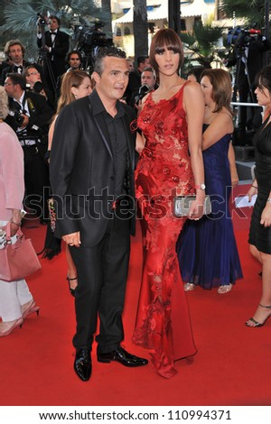 "CANNES, FRANCE - MAY 19, 2009: Cyclist Richard Virenque & Jessica Sow at the premiere of ""Broken Embraces"" in competition at the 62nd Festival de Cannes."
