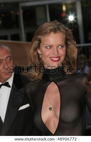 CANNES, FRANCE - MAY 14: Czech model Eva Herzigova attends a screening of 'Cache' at the Grand Theatre during the 58th International Cannes Film Festival May 14, 2005 in Cannes, France - stock photo