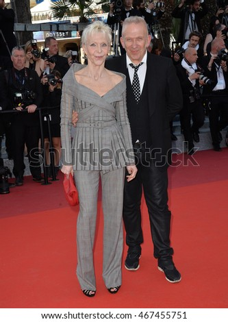"CANNES, FRANCE - MAY 15, 2016: Designer Jean Paul Gaultier & Tonie Marshall at the gala premiere of ""From the Land of the Moon"" (""Mal de Pierres"") at the 69th Festival de Cannes."