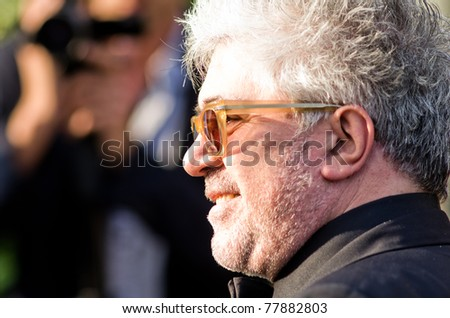 CANNES, FRANCE - MAY 19: director pedro almodovar leaves hotel martinez during the 64th Annual Cannes Film Festival on May 19, 2011 in Cannes, France. - stock photo