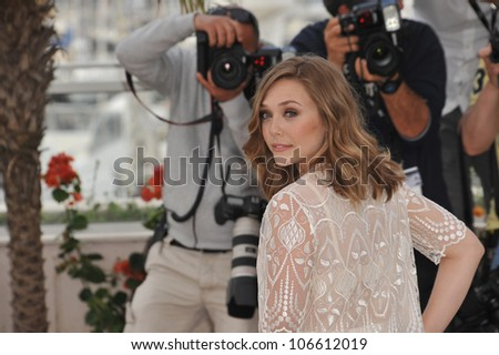 "CANNES, FRANCE - MAY 15, 2011: Elizabeth Olsen at the photocall for her movie ""Martha Marcy May Marlene"" at the 64th Festival de Cannes. May 15, 2011  Cannes, France"