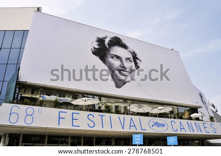 CANNES, FRANCE - MAY 14: Facade of the Palais des Festivals with the billboard of the 68 edition of the Cannes Film Festival on May 14, 2015 in Cannes, France - stock photo