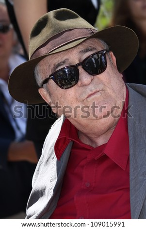 CANNES, FRANCE - MAY 23: FIlmmaker Bernardo Bertolucci attends the 'Io E Te' Photocall during the 65th Annual Cannes Film Festival at Palais des Festivals on May 23, 2012 in Cannes, France. - stock photo