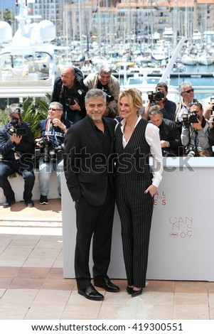CANNES, FRANCE - MAY 12: George Clooney and Julia Roberts attend the 'Money Monster' Photocall at the annual 69th Cannes Film Festival at Palais des Festivals on May 12, 2016 in Cannes, France. - stock photo