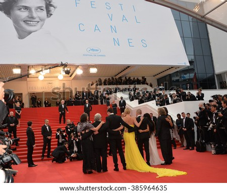 "CANNES, FRANCE - MAY 14, 2015: George Miller & Nicholas Hoult,Charlize Theron, Tom Hardy, Zoe Kravitz and Doug Mitchell  at the gala premiere of ""Mad Max: Fury Road"" at the 68th Festival de Cannes. - stock photo"