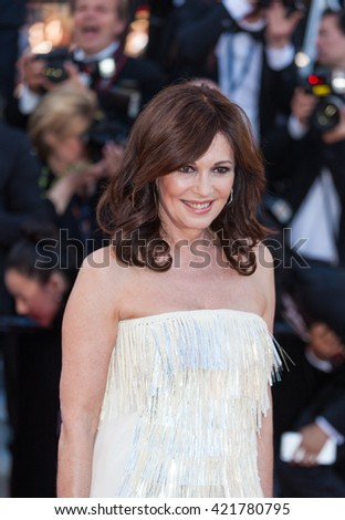 Cannes, France - 15 MAY 2016 - Iris Berben wearing a white dress by Talbot Runhof during the 'From The Land Of The Moon (Mal De Pierres)' premiere during the 69th annual Cannes Film Festival - stock photo