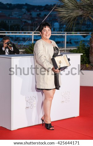 Cannes, France - 22 MAY 2016 - Jaclyn Jose poses after being awarded Best Actress prize for the movie Ã??MaÃ??RosaÃ?? during the Palme D'Or Winner Photocall during the 69th annual Cannes Film Festival - stock photo