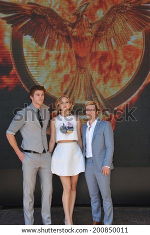 "CANNES, FRANCE - MAY 17, 2014: Jennifer Lawrence, Liam Hemsworth (left) & Josh Hutcherson at photo call for their movie ""The Hunger Games: Mockingjay - Part 1"" at the 67th Festival de Cannes.  - stock photo"
