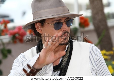 CANNES, FRANCE - MAY 14: Johnny Depp attends the 'Pirates of the Caribbean: On Stranger Tides' photocall at the Palais des Festivals during the 64th Cannes  Festival on May 14, 2011 in Cannes, France. - stock photo