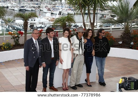 CANNES, FRANCE-MAY 14:Johnny Depp (3rd R) attends the 'Pirates of the Caribbean: On Stranger Tides' photocall at the Palais des Festivals during the 64 Cannes Festival on May 14, 2011 in Cannes, France - stock photo
