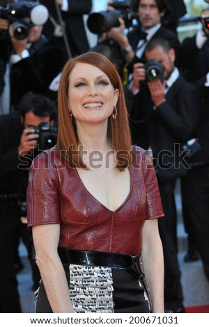 "CANNES, FRANCE - MAY 15, 2014: Julianne Moore at the premiere of ""Mr. Turner"" at the 67th Festival de Cannes.  - stock photo"