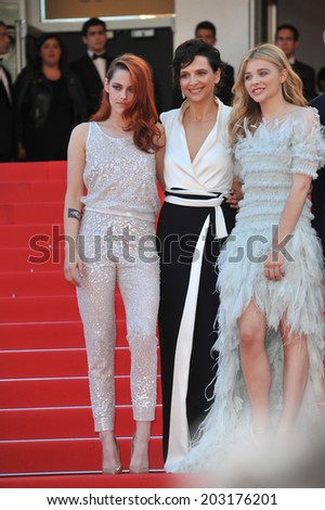 """CANNES, FRANCE - MAY 23, 2014: Juliette Binoche, Kristen Stewart & Chloe Grace Moretz at gala premiere of their movie """"Clouds of Sils Maria"""" at the 67th Festival de Cannes.  - stock photo"""