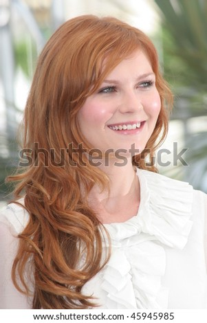 CANNES, FRANCE - MAY 24:  Kirsten Dunst attends a photocall promoting the film 'Marie Antoinette' at the Palais des Festivals during the 59th  Cannes Film Festival on May 24, 2006 in Cannes, France - stock photo