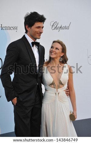 CANNES, FRANCE - MAY 23, 2013: Kylie Minogue & Andres Velencoso at amfAR's 20th Cinema Against AIDS Gala at the Hotel du Cap d'Antibes, France  - stock photo