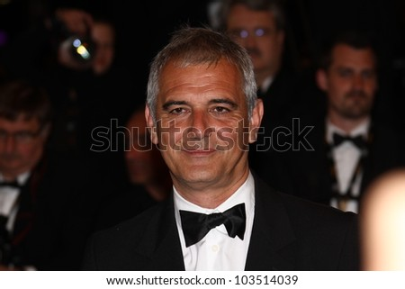 CANNES, FRANCE - MAY 23: Laurent Cantet attends the 'Holy Motors' Premiere during the 65th Annual Cannes Film Festival at Palais des Festivals on May 23, 2012 in Cannes, France. - stock photo