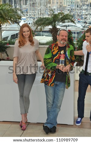 "CANNES, FRANCE - MAY 22, 2009: Lily Cole & Terry Gilliam at the photocall for their new movie ""The Imaginarium of Doctor Parnassus"""
