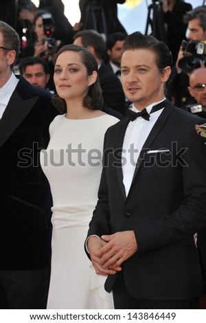"CANNES, FRANCE - MAY 23, 2013: Marion Cotillard & Jeremy Renner at the premiere of their movie ""The Immigrant"" at the 66th Festival de Cannes.  - stock photo"